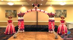 Castle Balloon Arch with Minnie Mouse balloon topper and Princess balloon Sculptures. Great for a combination party theme idea. #partywithballoons