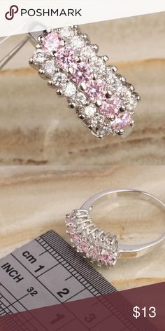 Pink sapphire white diamond ring Pink sapphire gemstone . White cubic zirconia diamond. White gold plated . Size 6. Brand new. Never worn. Wrapped up and shipped with care. Ice Jewelry Rings