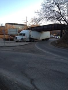 """""""Always check your vehicle's height before you leave as part of your pre-trip inspection!"""" Tractor-trailer stuck under bridge Posted by: MyNews contributor Crystian Marinez shared this photo of a tractor-trailer that became stuck when it tried to drive under a low bridge in Edmonton on Wednesday, March 14, 2012."""