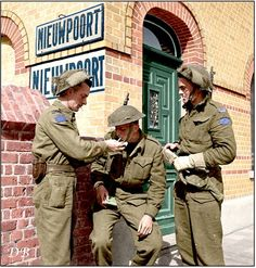 Sgt. Wilson, Privates P.J. Kraft and Henry Edward Looker, infantrymen of the South Saskatchewan Regiment, 6th Infantry Brigade, 2nd Canadian Infantry Division in Pelikaanstraat, Nieuwpoort, Belgium. September 9 1944.