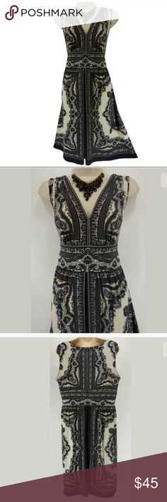 """Size 12 M/L▪️SEXY BLACK/IVORY PAISLEY SUMMER DRESS This gorgeous paisley dress is sexy, sweet, and fashionable!   Size: 12 Slip on/ slip off V-neckline  Stretchy, super comfortable fabric Eye-catching paisley print Measurements: Bust (armpit to armpit):  40"""" relaxed - stretches to 48"""" Waist: 33.5"""" relaxed - stretches to 36"""" Hips:  54"""" relaxed Length: 39"""" (top of shoulder to bottom hem)  Condition:  BRAND NEW WITH TAGS! Fabric Content: 95% Polyester  5% Spandex Fabric Care:  Machine Wash…"""