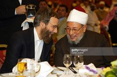 British Yusuf Islam, formerly Cat Stevens, the pop singer-turned Islamic preacher and chairman of the International Board of Educational Research and Resources (IBERR), shares a talk with Sheikh Yusuf Qardawi during a dinner at the 7th IBERR conference held in Doha, 27 December 2004. The conference, hosted by the Doha Academy, is focusing on educational challenges in the 21st century and will discuss an action plan for Muslim schools all over the world to introduce an Islamic curriculum.