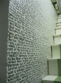 an excerpt from a book painted on a wall.