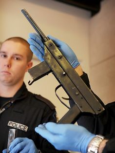 Home made Sub-machine gun seized during Rock Machine bikie raid. Crims gonna crim.