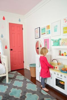 She wants a pink room and I was thinking maybe we could compromise with a pink door? Love the pink door and fun wall