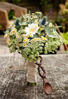 Wild flower, sea holly and daisy bouquet with welsh love spoon #wedding #bride #bouquet #lovespoon #welsh #flowers