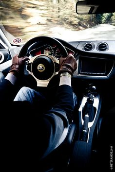 Everything on the inside is perfect....but he's in a Lotus & driving on a straight road? Hit the curvy stuff buddy.