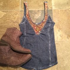 Free People Beaded Tank Beautiful acid wash blue (like a denim color) tank with beaded embellishment around neckline. Great condition, is missing beads, but you can't tell. There's an opening in the back, and shirt has intentional fade. 100% cotton, measurements to come. Boots not for sale nor included. NO TRADES Free People Tops Tank Tops