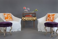 Justine Chair Verellen with linen slipcovers. Hickory Chair Suzanne Kasler's Anastasia Bench covered in royal purple velvet. Jane Schott Kilpatrick hand embroidered accent pillows. Mr. O Gold Leaf Vetrine. Hand made Necklaces by Mr. O.  Small bowl, Hybrid Collection by Seletti. Coffee table book 'The Impossible Collection of Jewelry'