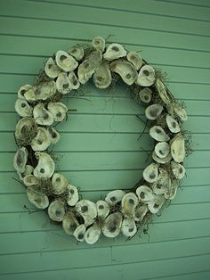 Oyster wreath for windows at reception hall.  Maybe use smaller wreaths for table settings?
