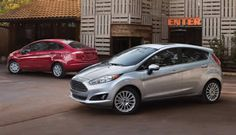 The Fiesta SE sedan with EcoBoost<sup>®</sup> Fuel Economy Package shown in Ruby Red Metallic Tinted Clearcoat on the left and the 2015 Fiesta Titanium hatch shown in Ingot Silver Metallic on the right.