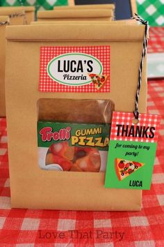 Fun favor bags at a pizza birthday party! See more party planning ideas at CatchMyParty.com!