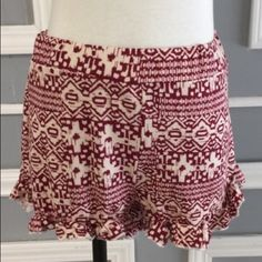 Cute Ruffle Shorts So cute! These shorts are great for the summer! Burgundy and off White color. Ruffled at the bottom with elastic band at waist. Made in USA. 95% rayon and 5% spandex. Goes well with a crop top. April Spirit Shorts