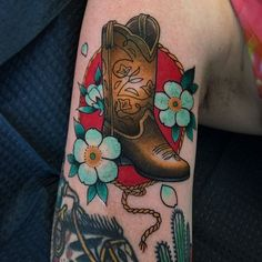 Cowboy boot tattoo by littlejennsmall otziapp com Cowboy Boot Tattoo, Cowgirl Tattoos, Western Tattoos, Cowboy Boots, Cross Shoulder Tattoos, Anniversary Tattoo, Texas Tattoos, Cross Tattoo For Men, Tattoo Portfolio