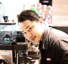 """""""I had to make four espressos and four cappuccinos in nine minutes to win the competition,"""" explains Tenny while he pours freshly steamed milk into a cup. Born in Manado but raised everywhere else, as he puts it, this talented barista has belted long hours behind the bar.  Aston Kuta Hotel & Residence 