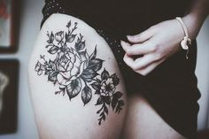 Thigh tattoo.