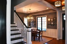 Foyer redo -- love!  Change out tile floors to hardwood.  Change stairway to painted/stained wood; remove carpeting. Paint walls