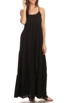 Black spaghetti-strap maxi dress that is perfect for a casual day out, or for dressing up! 100% Polyester fabric is soft and hangs beautifully, making the dress flattering for many shapes/sizes, while also keeping you cool on those hot days. The dress is simple, but has an embroidered lace ribbon on the upper waist-line, and the bottom is split into three panels to add a special touch! Made in the United States.   Black Maxi Dress by Chris & Carol. Clothing - Dresses - Maxi North Carolina
