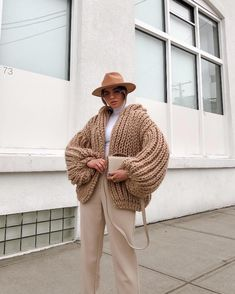 """The """"Bomber"""" is our authentic handmade knitted, short jacket. A chunky, ribbed cardigan with a saggy hood to protect you from the au Classy Outfits, Chic Outfits, Winter Fashion Outfits, Autumn Fashion, Fedora Outfit, Sweet 16 Dresses, Chunky Cardigan, Knitted Coat, Everyday Outfits"""