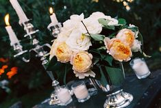 ivory, coral and silver wedding floral centerpiece photo by Yvette Roman Photography