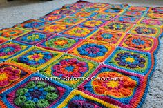 Bright Flower Afghan By Kristi - Free Crochet Pattern - Pattern Square For Blanket is By Barbara Smith At - http://made-in-k-town.blogspot.de/2013/02/african-flower-square-tutorial.html - (knottyknotty.blogspot)