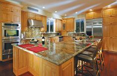 Canyon Creek - Windsor in Cornerstone framed cabinetry with a Pecan stain eclectic kitchen
