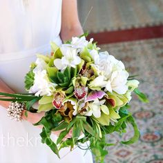 bouquet with succulents, cymbidium orchids, lady's slipper orchids, rolled lily grass, and wave leaf