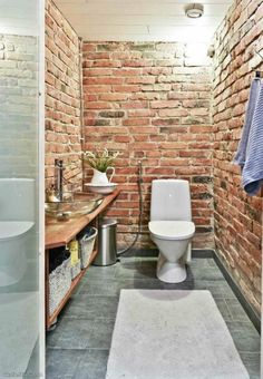 Red Brick Walls In A Toilet