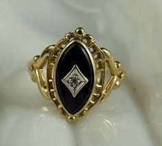 Delicate Vintage 10K Gold Onyx and Diamond Ring from ornaments on Ruby Lane