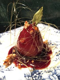 Pear poached in black cherry concentrate with candied walnuts and spun sugar