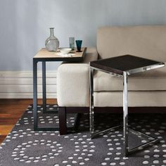 CS:  This is a C Table.  These would be great buy.  I've seen nicer/less shiny ones.  Will look sharp with sofa or next to chair.    Furniture for a Compact Living Space - Decoist