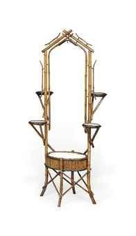 AN ARTS AND CRAFTS BRASS-MOUNTED BAMBOO PLANT STAND  LATE 19TH CENTURY