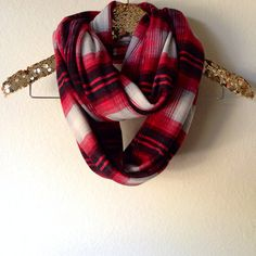"""Handmade infinity scarf Made with a stretch knit Print is a red plaid Can be worn as a single layer or doubled We recommend wearing this scarf singled Scarf measures Width 21"""" and Circumference 61"""" Hand wash in cold and lay flat to dry if needed TF"""