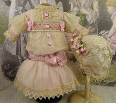 Wonderful French pink cotton and gauze antique doll dress and matching antique bonnet for Jumeau, Bru, Gaultier, Steiner or other Bébé from Stairwaytothepast on Ruby Lane.
