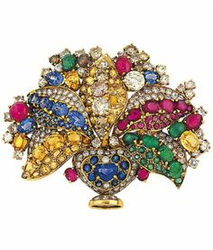A diamond, coloured diamond and gem-set brooch, by Moroni Designed as a stylised basket of flowers, set throughout with vari-cut diamonds and vari-coloured diamonds, emeralds, rubies, sapphires and yellow sapphires, twin prong fitting, 7.7cm wide, maker's pouch, coloured diamonds not tested for natural origin Signed F. Moroni