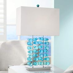 Illuminate any space beautifully with this bubble glass table lamp. In a bright blue color that is offset by a bright white box lamp shade. From Possini Euro Design. Glass Table, A Table, Chandeliers, Glass Chandelier, Blue Table Lamp, Table Lamps, Ocean Room, Blue Lantern, Cool House Designs