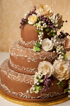 Lunds and Byerly's Wedding Cakes  - Wine Country - Chocolate -     Bountiful colors and harvest grapes cascade down this beautiful chocolate fondant cake.