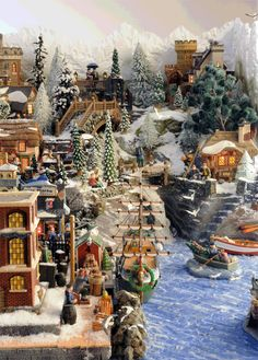 Someday I'd really like to get all my Christmas village pieces together and do something nice.  Of course mine is nothing as ornate as these here.