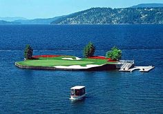The worlds only movable floating green, #13 at Couer d'Alene Idaho, about 85 yards from the front tees, 150-170 middle tees and 200 from the back tees. A dream hole. I'm 1 for 2 hitting the green from middle tees.