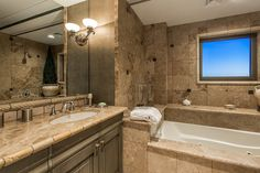 The master suite offers a leisurely escape to enjoy breathtaking views right from bed or around the cozy fireplace. Selling Real Estate, Luxury Real Estate, Cozy Fireplace, Corner Bathtub, Master Suite, Luxury Homes, Las Vegas, Bed, Beautiful