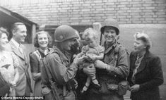 American soldiers of the 101st Airbourne Division celebrate with the local children in Eindhoven 1944