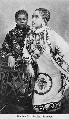 Africa | Two Arab Ladies. Zanzibar. Dated 1920. | Vintage postcard; photographer A.C. Gomes and Son
