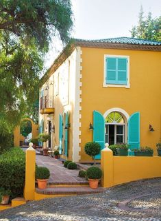 Image result for turquoise yellow houses