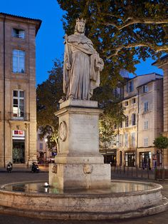 The fountain of King René, on the Cours Mirabeau in Aix-en-Provence, Provence, France, in early evening.