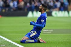 Leicester City's Algerian midfielder <a gi-track='captionPersonalityLinkClicked' href=/galleries/search?phrase=Riyad+Mahrez&family=editorial&specificpeople=9166027 ng-click='$event.stopPropagation()'>Riyad Mahrez</a> celebrates scoring the opening goal during the English Premier League football match between Leicester City and Swansea at King Power Stadium in Leicester, central England on April 24, 2016. / AFP / BEN STANSALL / RESTRICTED TO EDITORIAL USE. No use with unauthorized audio…