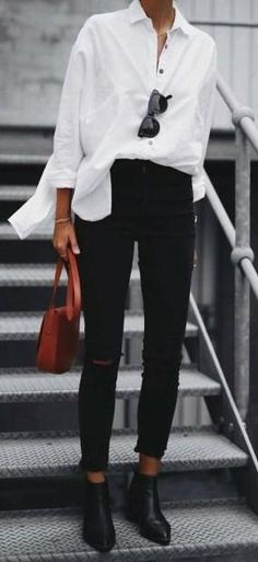 Over-sized White Shirt, Black Skinnies & Burnt Sienna accent.