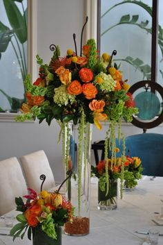 My Photo Album Wedding Reception Photos on WeddingWire  I like the light green mixed in with these colors!!! Simple Elegant Centerpieces, Tall Wedding Centerpieces, Tall Centerpiece, Fall Wedding Decorations, Reception Ideas, Wedding Reception, Orange Wedding Flowers, Wedding Stuff, Wedding Ideas