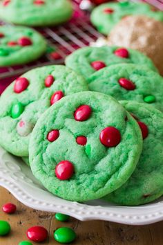 Despite their name, these Grinch Cookies are just about as festive and holiday friendly as can be! These soft and chewy cookies are colored Grinch green and decorated with milk chocolate candy pieces. Sam here again from Sugar Spun Run! Christmas Cookies Grinch, Grinch Cookies, Easy Christmas Cookie Recipes, Christmas Snacks, Xmas Cookies, Christmas Cooking, Holiday Desserts, Holiday Baking, Holiday Recipes