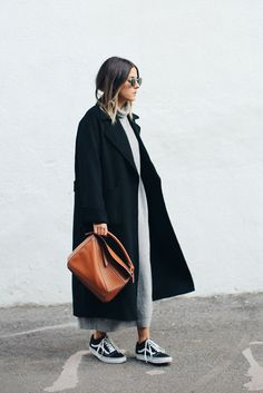 Loving this oversize black coat so much. Perfectly accessorised here with sunnies, handbag, and trainers in complementary colours.
