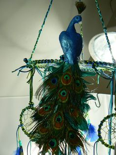 photo 1 of 5 Peacock Mobile by Winchestergems on Etsy - Handmade item - Materials: feathers, hoops, pony beads, cord, metal hoops - Ships worldwide from Lind, Washington (sold and appears to be one of a kind )